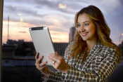 A job seeker is using an iPAD to look for a new job